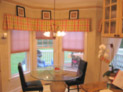 Honeycomb shades and box-pleated valance for eat-in kitchen in a Westchester home